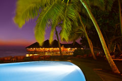 Pool and cafe on tropical Maldives island Royalty Free Stock Photo
