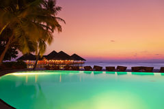 Pool and cafe on tropical Maldives island Royalty Free Stock Images