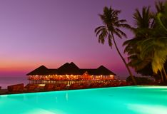 Pool and cafe on tropical Maldives island Stock Photography