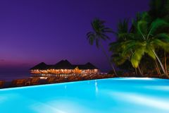 Pool and cafe on tropical Maldives island Stock Images