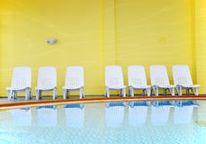 Pool Chairs empty. In hotel on caribbean sea Royalty Free Stock Photo