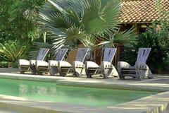 Pool chairs at resort Royalty Free Stock Photos