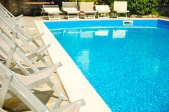 Pool in hotel. Pool with chaise-longues in hotel royalty free stock image