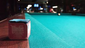 Pool chalk on green wooden table. Focus on pool chalk stock photography