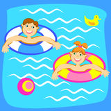 Pool with children. Smiling boy and girl playing on the water Stock Image