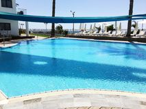 Empty pool without tourists early morning at hotel. Royalty Free Stock Photos