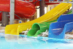Pool with clear water and multi-colored water slides Stock Image