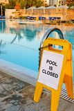 Pool Is Closed. Signage of POOL IS CLOSED. Swimming pool in one of top hotels in Limassol Royalty Free Stock Image
