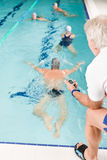Pool coach - swimmer training competition. Swimming pool - swimmer training competition in class with coach Royalty Free Stock Images