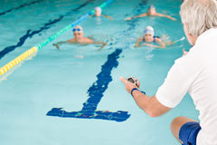 Pool coach - swimmer training competition Stock Photo