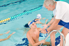 Pool coach - swimmer training competition Royalty Free Stock Photography