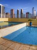 Pool in condominium Stock Images