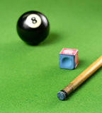 Pool Cue and 8 ball and chalk royalty free stock images