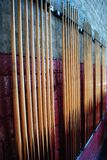 Pool Cues. Hanging in a pool hall stock image