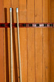 Pool cues. In bar or billiards hall royalty free stock photography
