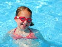 Pool de nadada da menina fotografia de stock