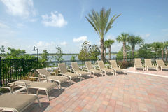 Pool Deck. A Deck with Chairs overlooking a Lake Royalty Free Stock Photos