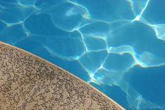 Pool Deck. Blue pool water and concrete pool deck stock image