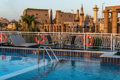 Pool deck luxury boat cruise ship in egypt luxor during dawn sunset.  stock image