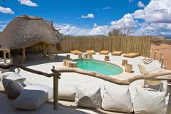 Pool of a luxury Lodge Namib-Naukluft Park Namibia. Pool and deck of a luxury Lodge Little Kulala in the desert of Namib-Naukluft National Park with short stock photography