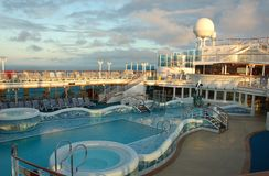 Pool deck on modern cruise ship. Amenities and fun on board a ship Royalty Free Stock Photography