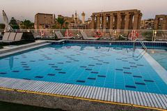 Pool deck and parasols of luxury boat cruise ship in egypt luxor during dawn sunset.  royalty free stock images
