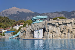 Pool with decorative rock on the territory of the Hotel Marco Po Stock Photography