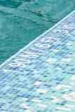 Pool depth indicator. Blue swimming pool and depth indicator Stock Image