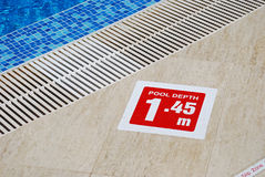 Pool depth sign. Red pool depth sign, water, overflow drain stock image