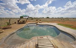 Pool on desert Stock Photo