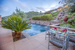 Pool and eating area in luxury home San Diego County Stock Photography