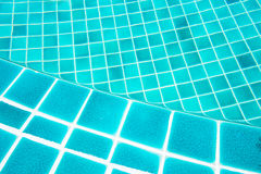 Pool edge. Beautiful blue water texture Stock Image