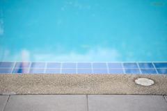 Pool edge with water surface in turquoise blue color. For sport royalty free stock image