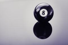 Pool eight ball on glass Royalty Free Stock Images