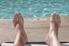 Pool Feet. A swimming pool beyond a pair of feet Stock Photography