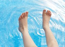 Pool and feet Stock Photo
