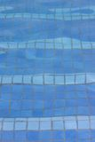 Pool floor texture. Texture of the pool floor with light bending and distorting the tiles on the bottom Stock Images