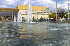 Pool with fountain in front of city sport center, Wieliczka, Pol Stock Image