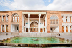 Pool with fountain inside the courtyard of Qajar dinasty historical building Asef mansion Stock Images