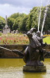 A Pool and Fountain in Port Sunlight. PORT SUNLIGHT, ENGLAND, JUNE 29. A pool and fountain on June 29, 2016, in Port Sunlight, England. A man and boy on a horse Royalty Free Stock Photography
