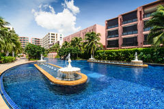 Pool with fountain water in hotel yard Stock Image