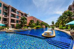 Pool with fountain water in hotel yard Royalty Free Stock Image