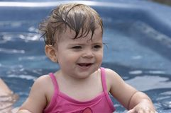 Pool fun. Young girl smiling in pool stock photos