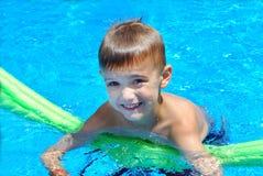 Pool fun. Young pool in the swimming pool Royalty Free Stock Photos