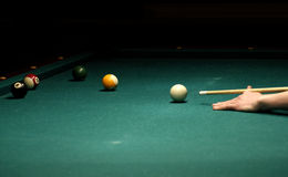 Pool game. Aiming white ball on green table royalty free stock image