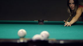 Pool game - a girl makes a blow to the balls stock footage