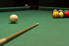 Pool game on green table. And chalk soft focus Stock Photography
