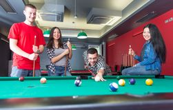Pool game. Group of friends playing pool together. concept about fun, friendship,leisure and people Stock Photo