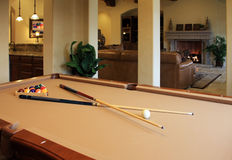 Pool game room. Adjoins modern home's family room stock images
