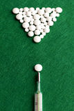 Pool game with white pills and thermometer on green felt backgro Royalty Free Stock Image